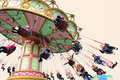 Happy people play chairoplane Royalty Free Stock Photo