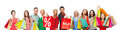 Happy people with sale sign on shopping bags Royalty Free Stock Photo