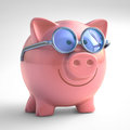 Happy piggy bank with sunglasses with clipping path included Stock Photos