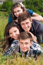 Happy Pile: Group Of Young Peo...
