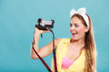 Happy pin up girl woman filming with camcorder. Royalty Free Stock Photo
