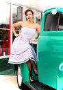 Happy Pinup Girl Sitting on Old Truck Royalty Free Stock Photo