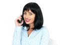 Happy pleased young woman using a cell phone or a chordless telephone smiling with short black dark hair in her twenties chord Stock Photos