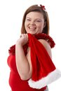 Happy plump woman with santa hat Royalty Free Stock Photos