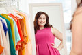 Happy plus size woman posing at home mirror clothing wardrobe fashion style and people concept Royalty Free Stock Images