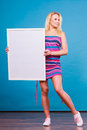 Happy positive blonde woman holding blank white board Royalty Free Stock Photo