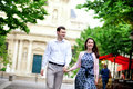 Happy positive couple walking near Sorbonne Stock Image
