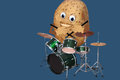 Happy potato drummer plays melody on drum set Stock Images