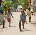 Happy poverty children the little boys playing with wheel at the remote village of tamilnadu india photo taken on january th Stock Photo