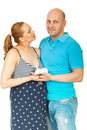 Happy pregnant couple holding baby shoes Stock Image
