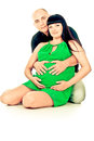Happy pregnant couple hugging Royalty Free Stock Images