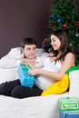 Happy pregnant couple near the christmas tree Stock Photography