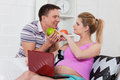 Happy pregnant family with fruit. Royalty Free Stock Photos