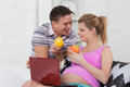 Happy pregnant family with fruit. Royalty Free Stock Photo