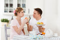 Happy pregnant family and healthy food Stock Images