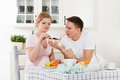 Happy pregnant family and healthy food Royalty Free Stock Photo