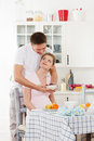 Happy pregnant family and healthy food Stock Image