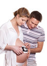 Happy pregnant family with ultrasound picture Royalty Free Stock Image