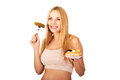 Happy pregnant woman with cake and pickles Royalty Free Stock Photo