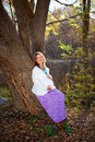 Happy pregnant woman in fall nature Stock Images