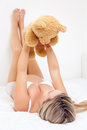 Happy pregnant woman holding a teddy bear up Royalty Free Stock Image