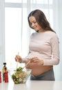 Happy Pregnant Woman Preparing...