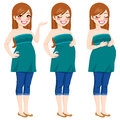 Happy pregnant woman pretty showing pregnancy growing process touching her belly Stock Photos
