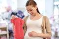 Happy Pregnant Woman Shopping ...