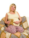 Happy pregnant woman on sofa isolated Stock Images