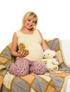 Happy pregnant woman on sofa isolated Royalty Free Stock Photography