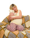 Happy pregnant woman on sofa isolated Stock Photo