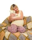 Happy pregnant woman on sofa isolated Stock Photo