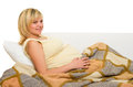 Happy pregnant woman on sofa isolated Royalty Free Stock Photo
