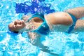 Happy pregnant woman swwing in swimmingpool Royalty Free Stock Images