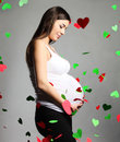 Happy pregnant woman touching her belly Royalty Free Stock Photo