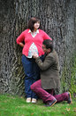 Happy pregnant woman women with her husband in the park Royalty Free Stock Photography