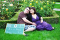 Happy pregnant woman women with her husband in the park Royalty Free Stock Images