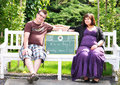 Happy pregnant woman women with her husband in the park Stock Photos