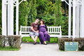 Happy pregnant woman women with her husband in the park Stock Images