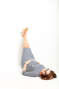 Happy pregnant women rests on floor legs up Royalty Free Stock Photo