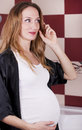 Happy pregnant young woman Stock Images