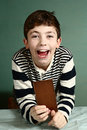 Happy preteen boy with chocolate bar Royalty Free Stock Photo