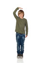 Happy preteen boy pointing measuring what has grown isolated on white background Royalty Free Stock Photo