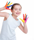 Happy pretty little girl with painted hands isolated on white Stock Images