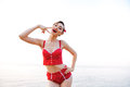 Happy pretty pinup girl in red swimsuit showing victory sign Royalty Free Stock Photo