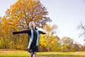 Happy pretty woman at the autumn park colored Royalty Free Stock Photos