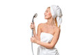 Happy pretty woman in towel singing using shower having fun Royalty Free Stock Photo