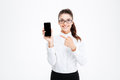 Happy pretty young businesswoman pointing on blank screen cell phone Royalty Free Stock Photo