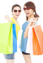 Happy pretty young sisters holding shopping bags in studio Royalty Free Stock Photo
