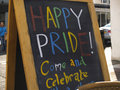 Happy pride restaurant board with text saying come and celebrate in celebration of gay festival brighton england Stock Photo